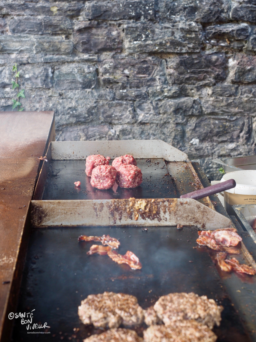 Beefy Boys burgers start out as a ball of meat on the grill which is then flattened