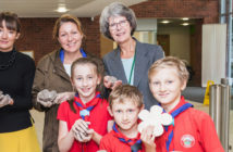 Council staff help Monmouthshire Scouts craft poppies to remember fallen soldiers